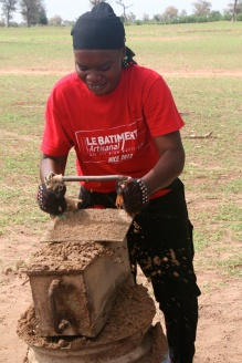 Fa working hard making some bricks.