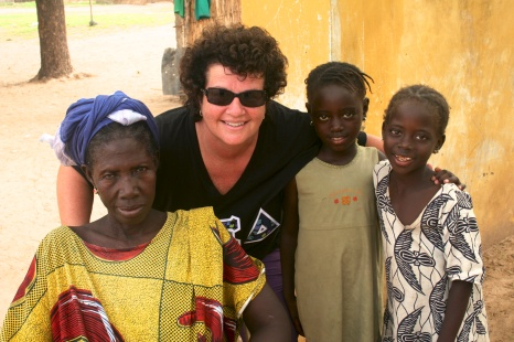 Ginny with a couple girls from the village and one of the women's group leaders.